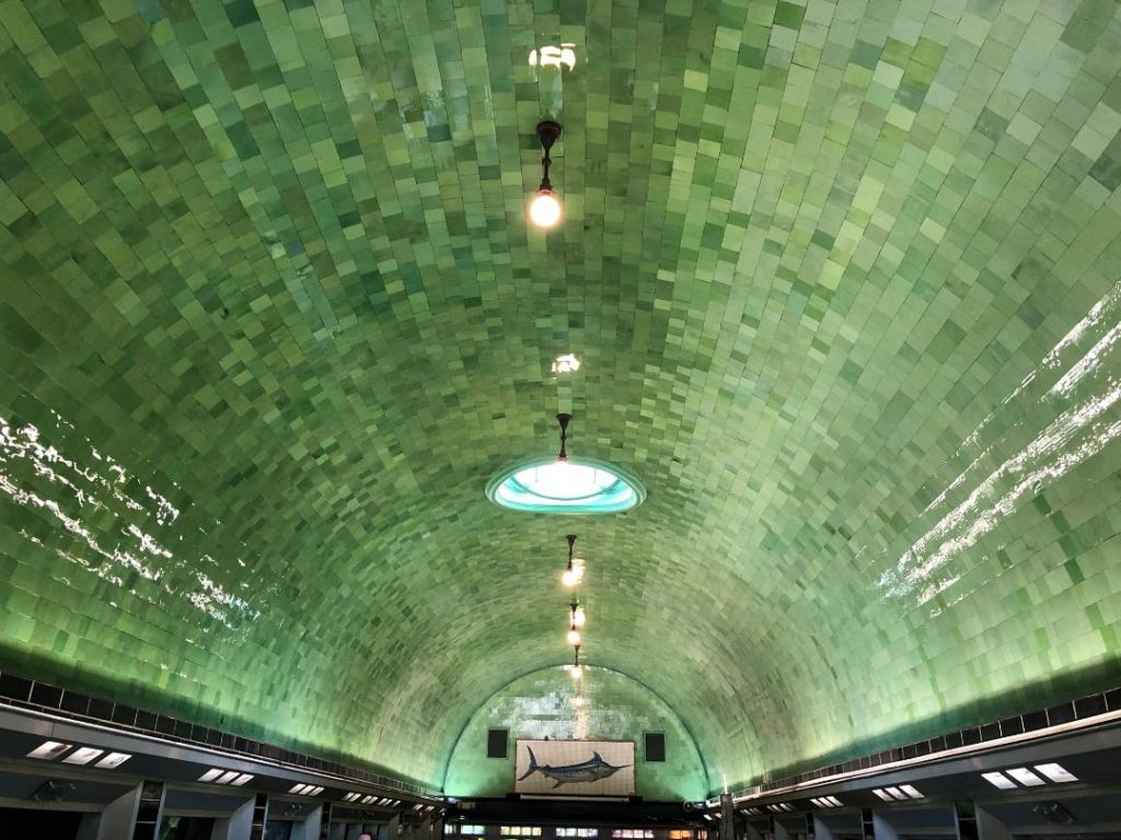 The beautiful green opalite glass tiles that line the vaulted ceiling of the Belle Isle Aquarium