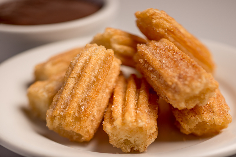 plate of cinnamon sugar churros