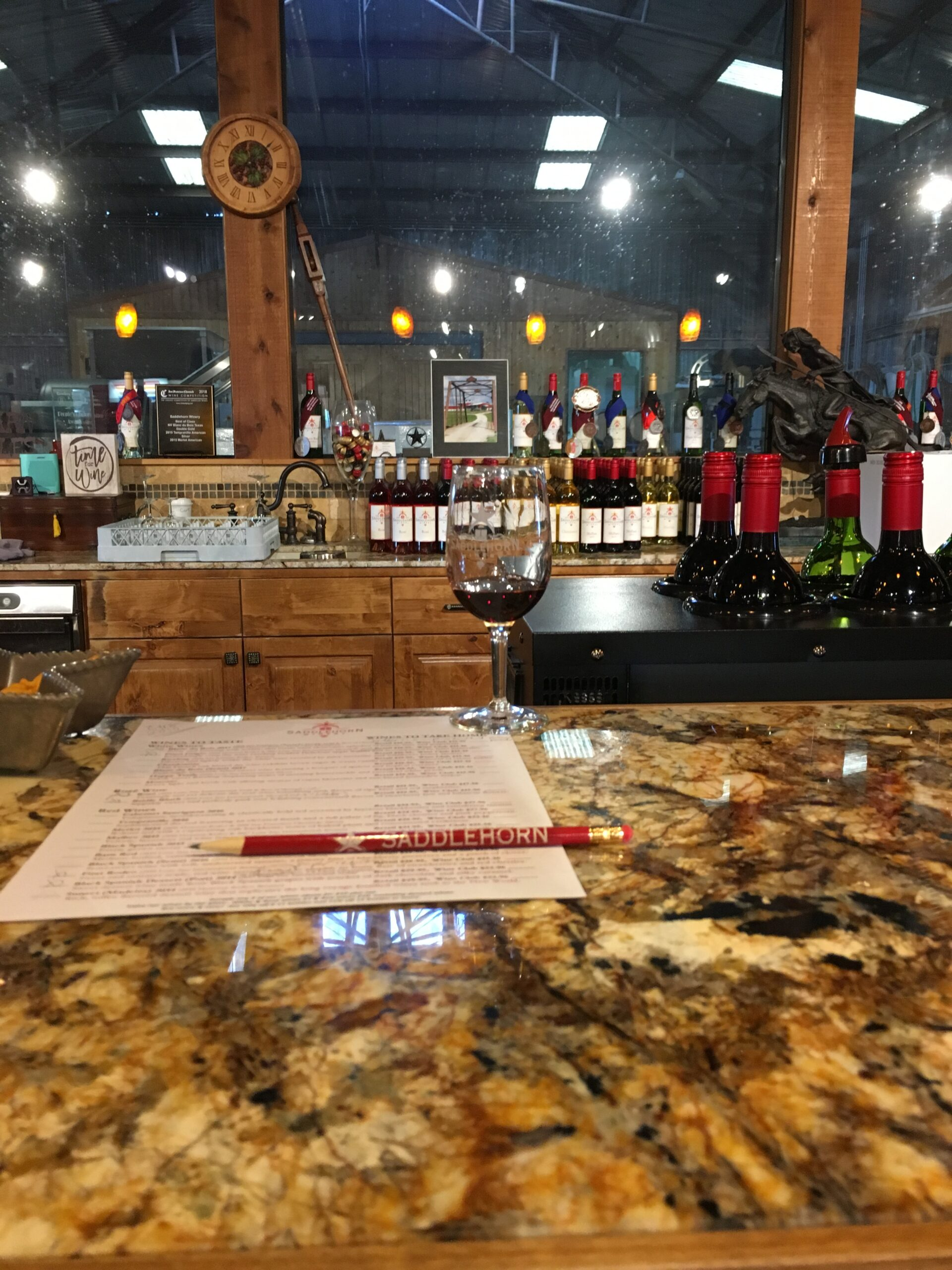 wine glass pencil and wine tasting form on wine tasting counter at saddlehorn winery in burton texas