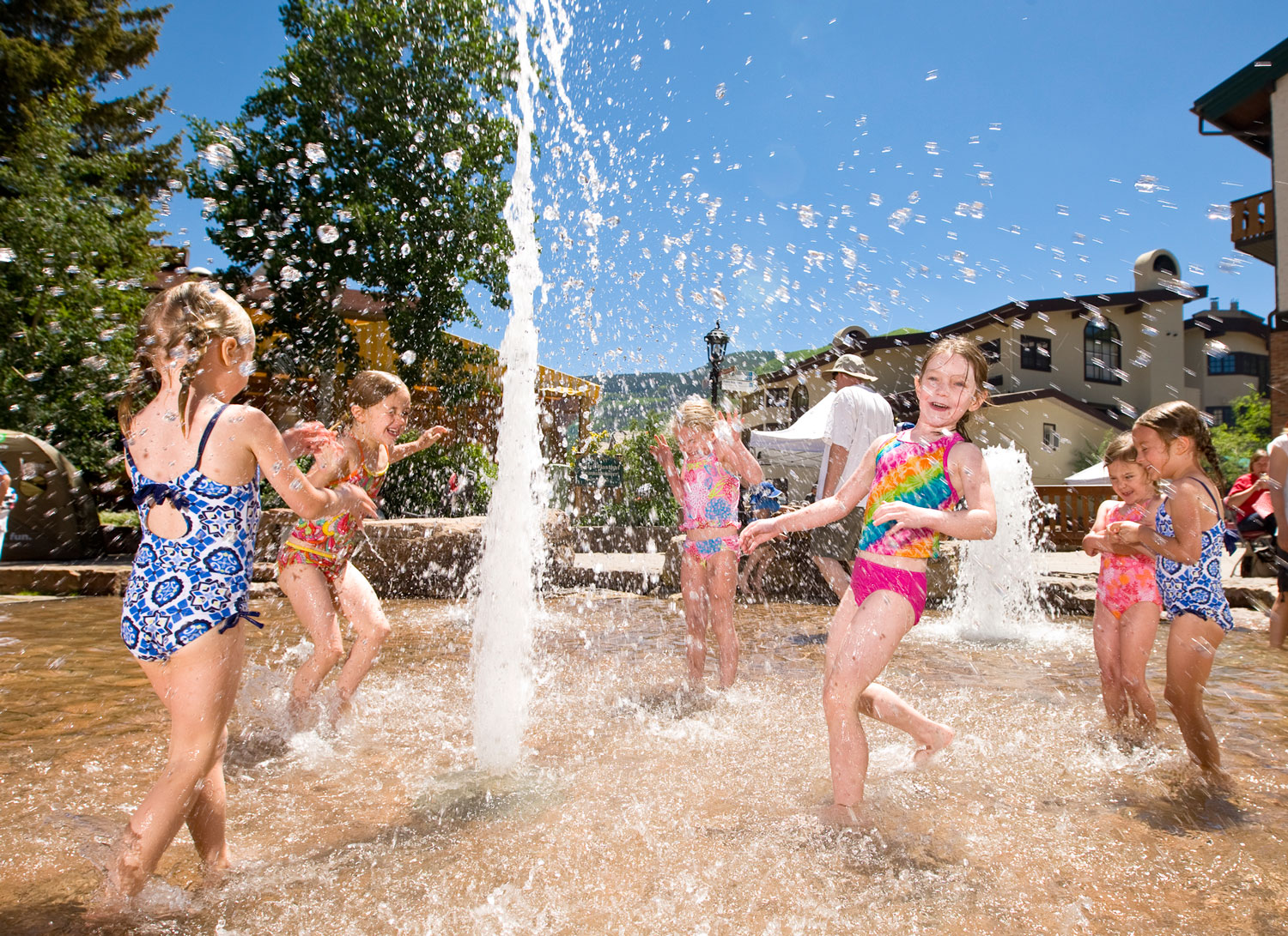 Kids splashing in the Vail children's fountain, one of the fun things to do in summer
