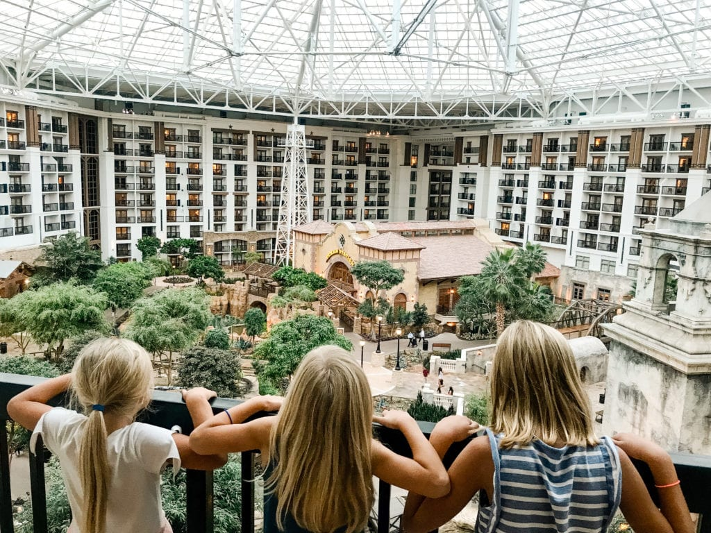 three little girls looking over the balcony inside their gaylord resort room