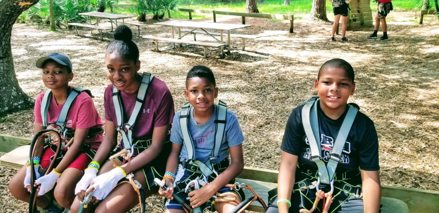 Four kids at Tree-Umph Adventure Course in Sarasota FL