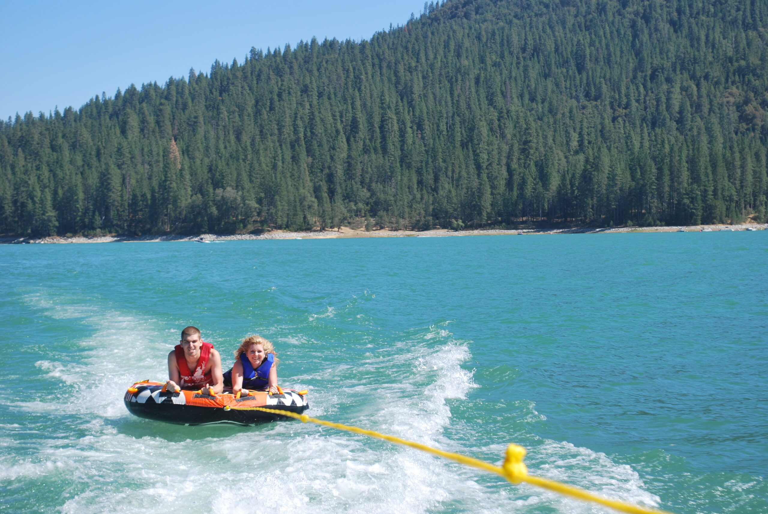 Mother and son on tube in Bass Lake CA