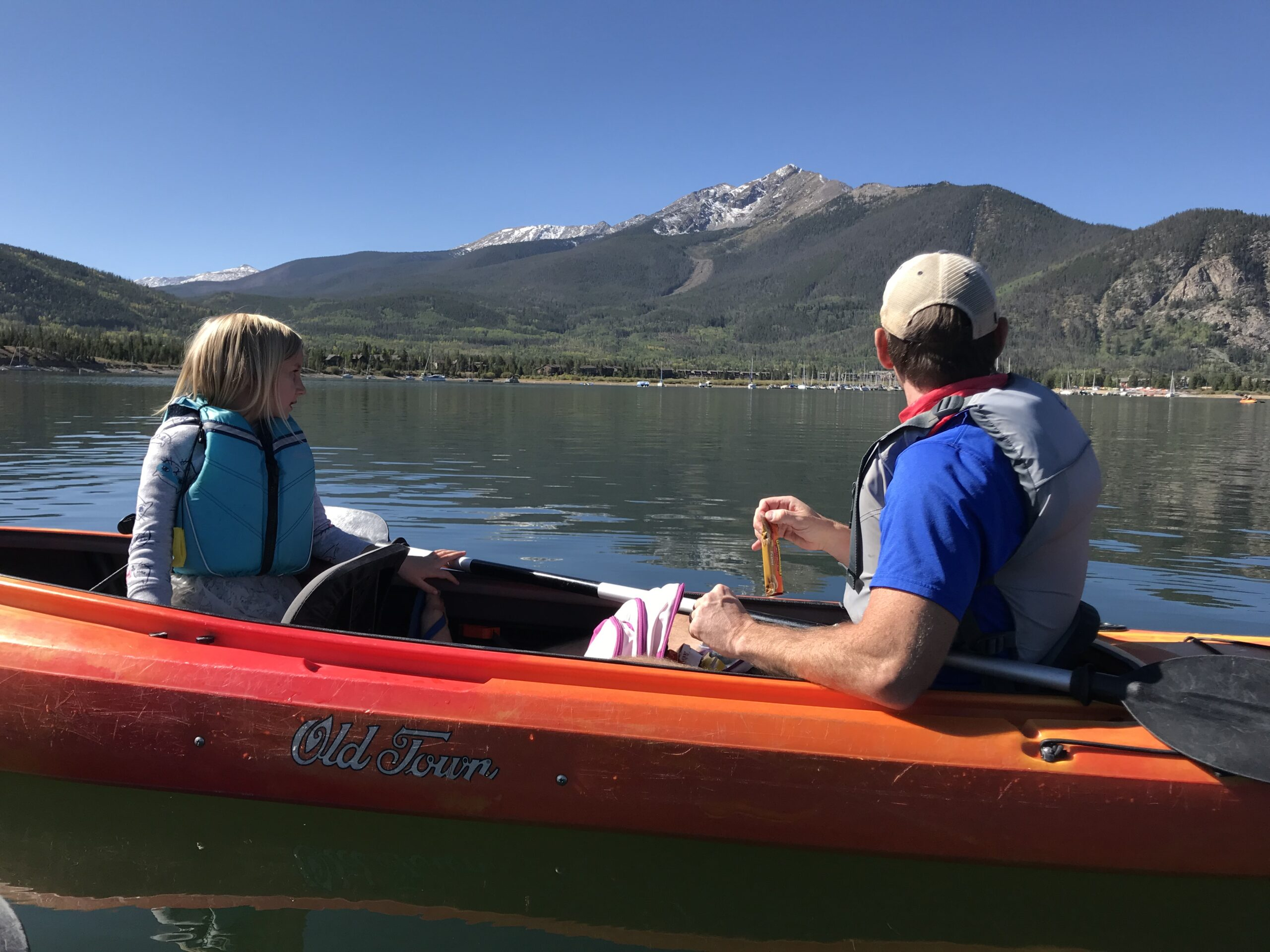 Dad and daughter kayaking on Lake Dillon, one of the best things to do in Frisco CO in the summer.