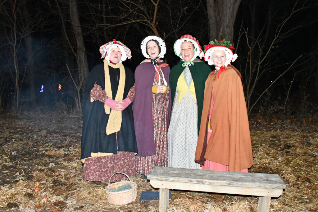 Carolers in period costumes at Conner Prairie's Merry Prairie Christmas Lights Display