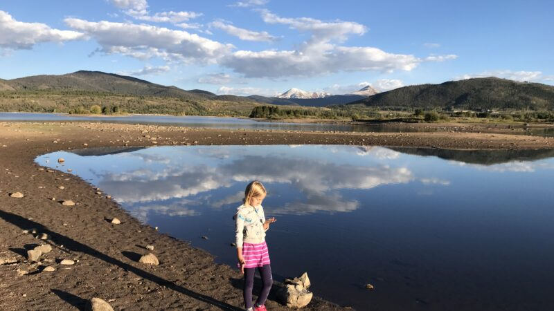 A girl explores Lake Dillon, one of the best things to do in Frisco CO