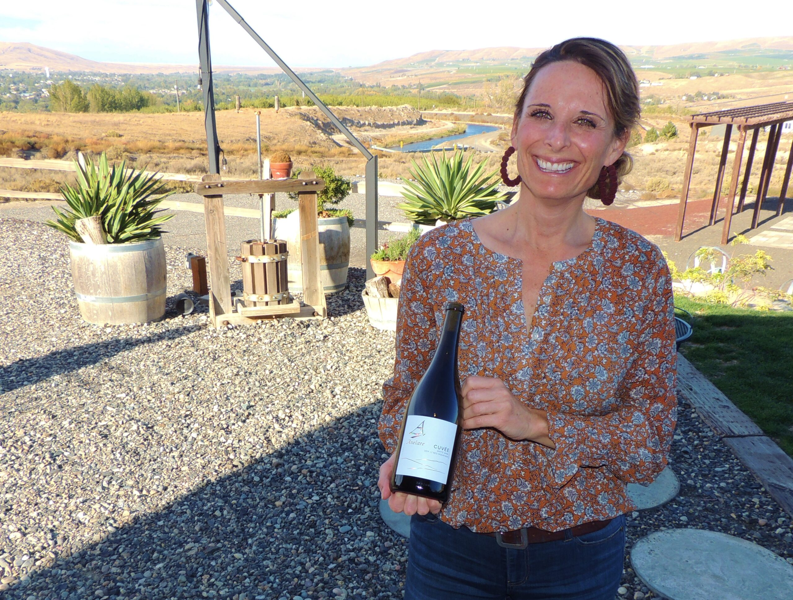 woman with wine at Harvest Hosts Anelare Winery
