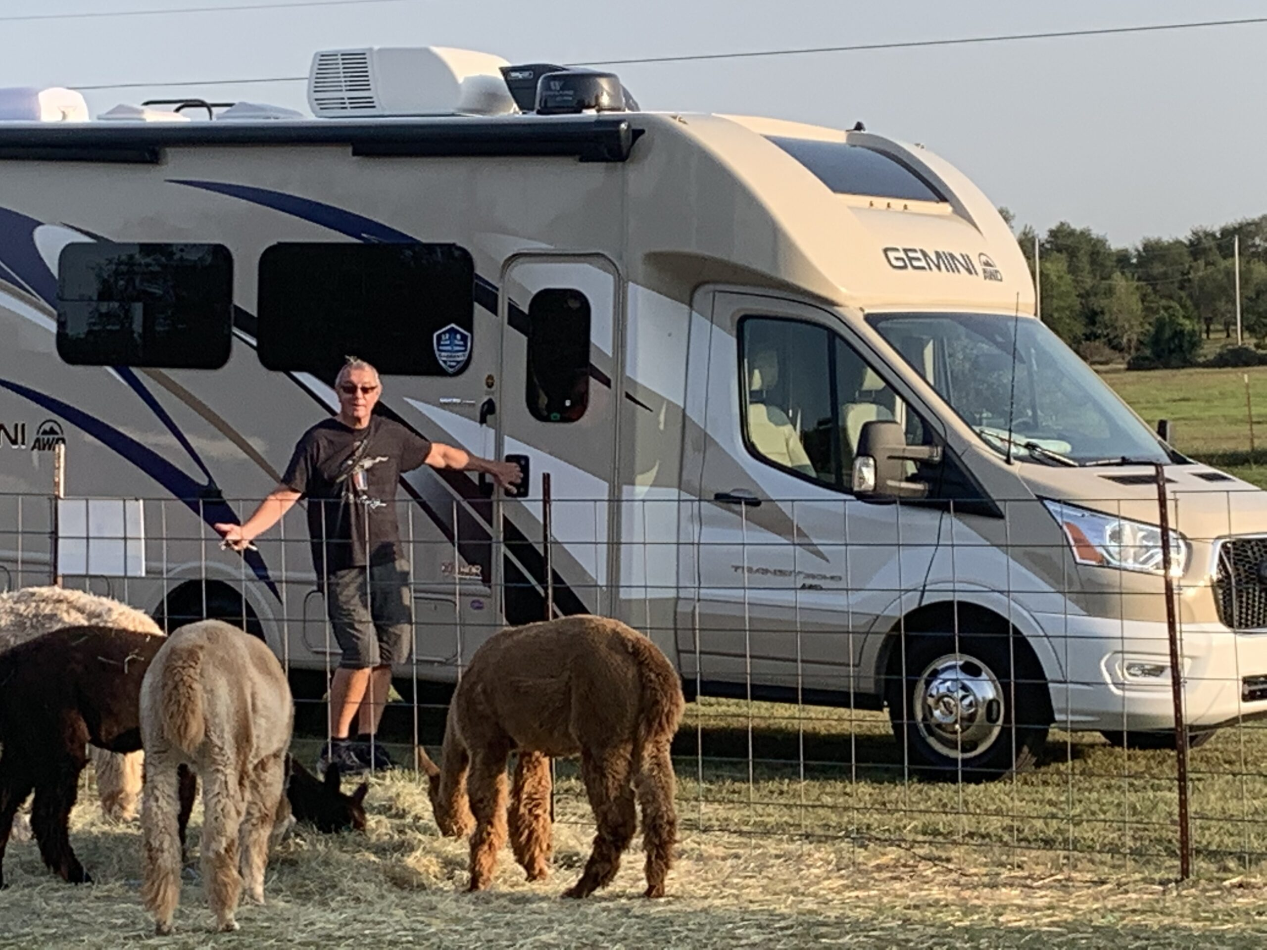 man with RV and alpacas at a Harvest Hosts member site