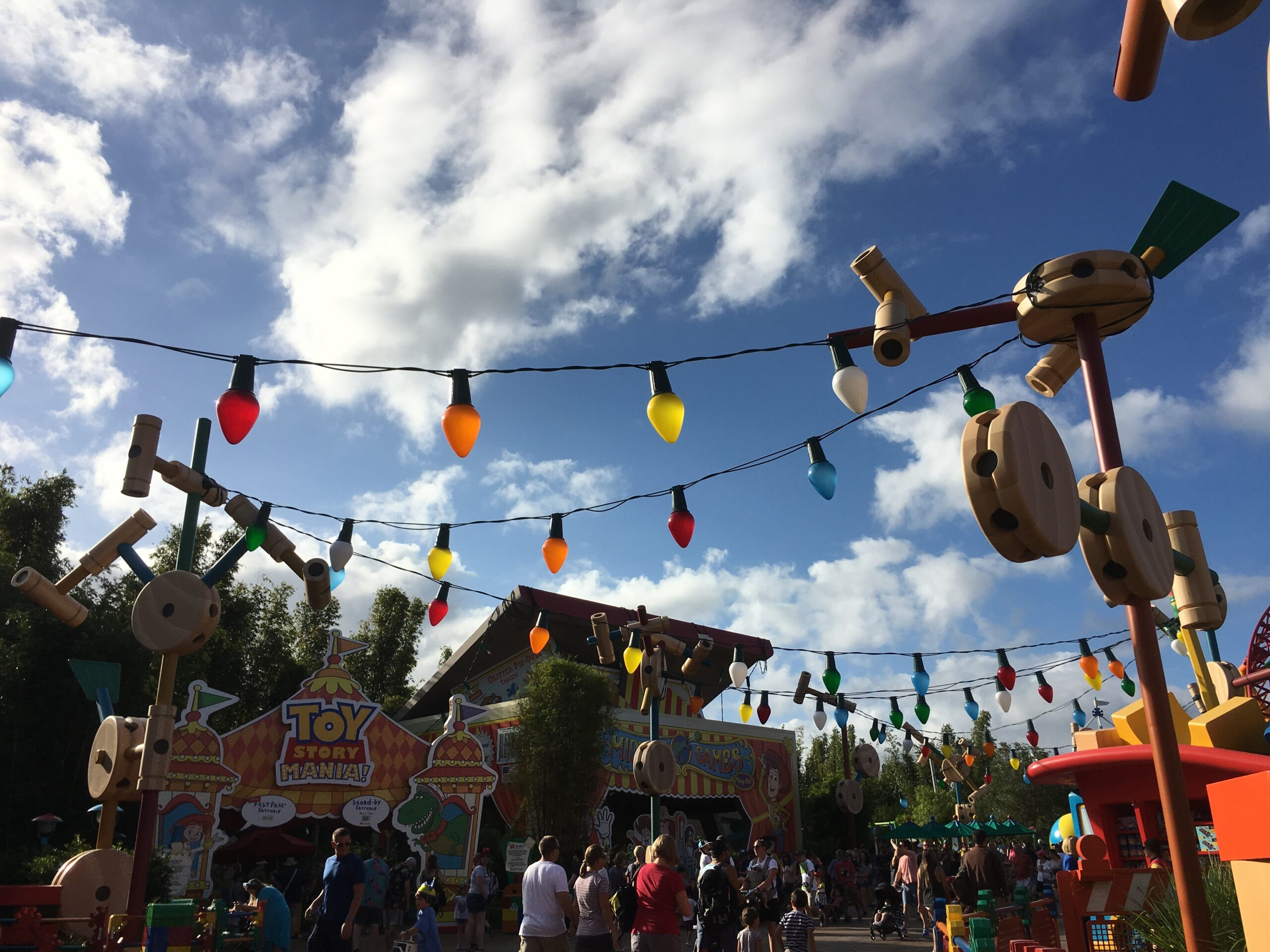 toy story land props giant tinker toys and strings of oversized christmas lights