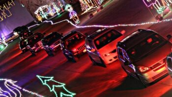 Cars driving through Lights Under Louisville, a drive through Christmas lights display in Kentucky.