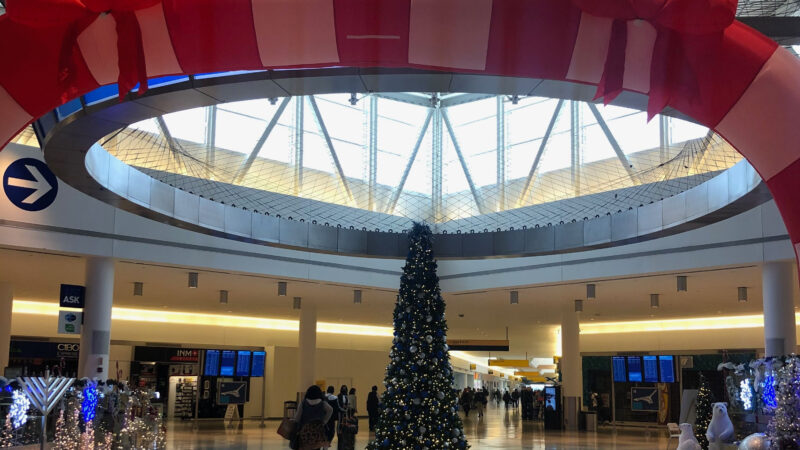 Christmas tree at a nearly empty terminal at JFK airport in New York City.