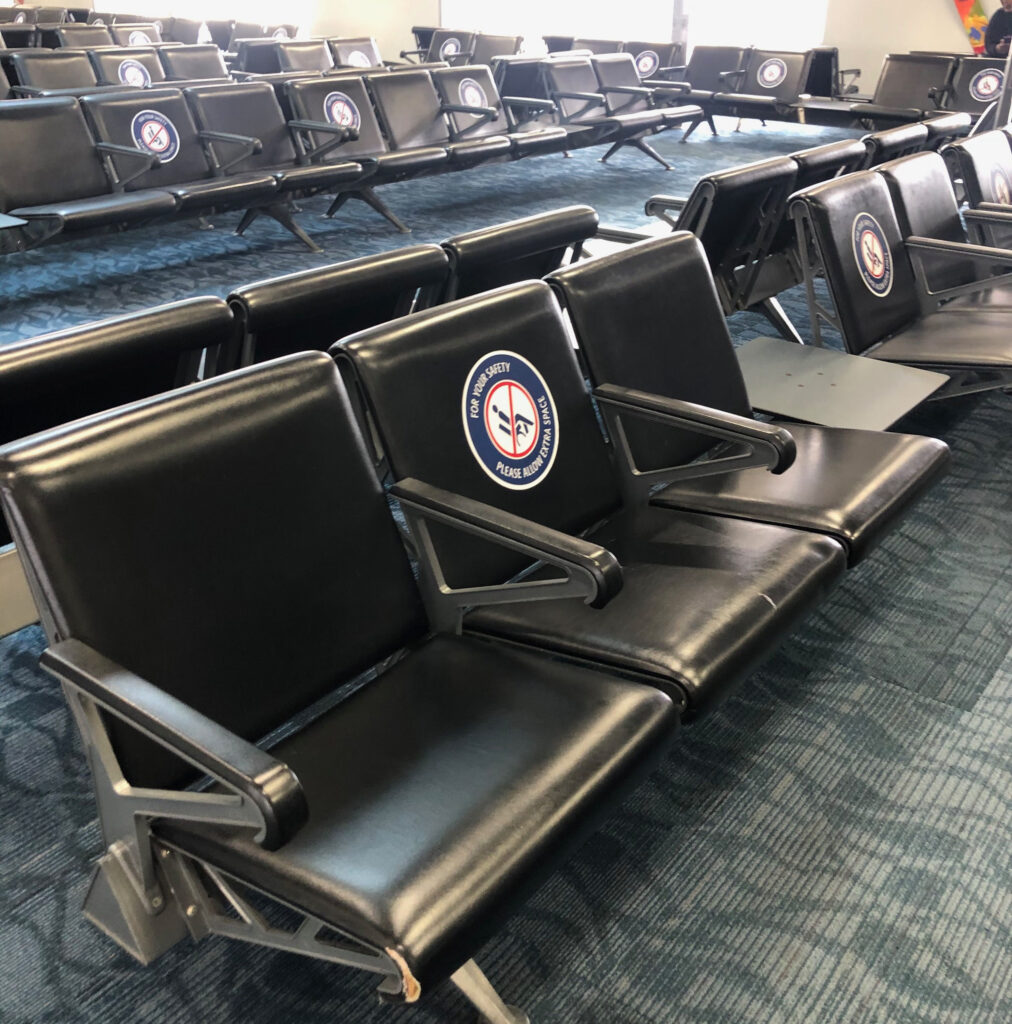 Social distancing seats marked at a departure gate at JFK airport in New York City