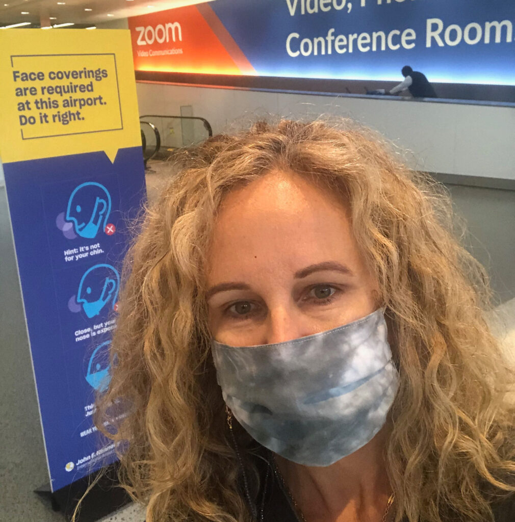 ravelingMom Founder Kim Orlando wearing a face mask at JFK airport in New York City.
