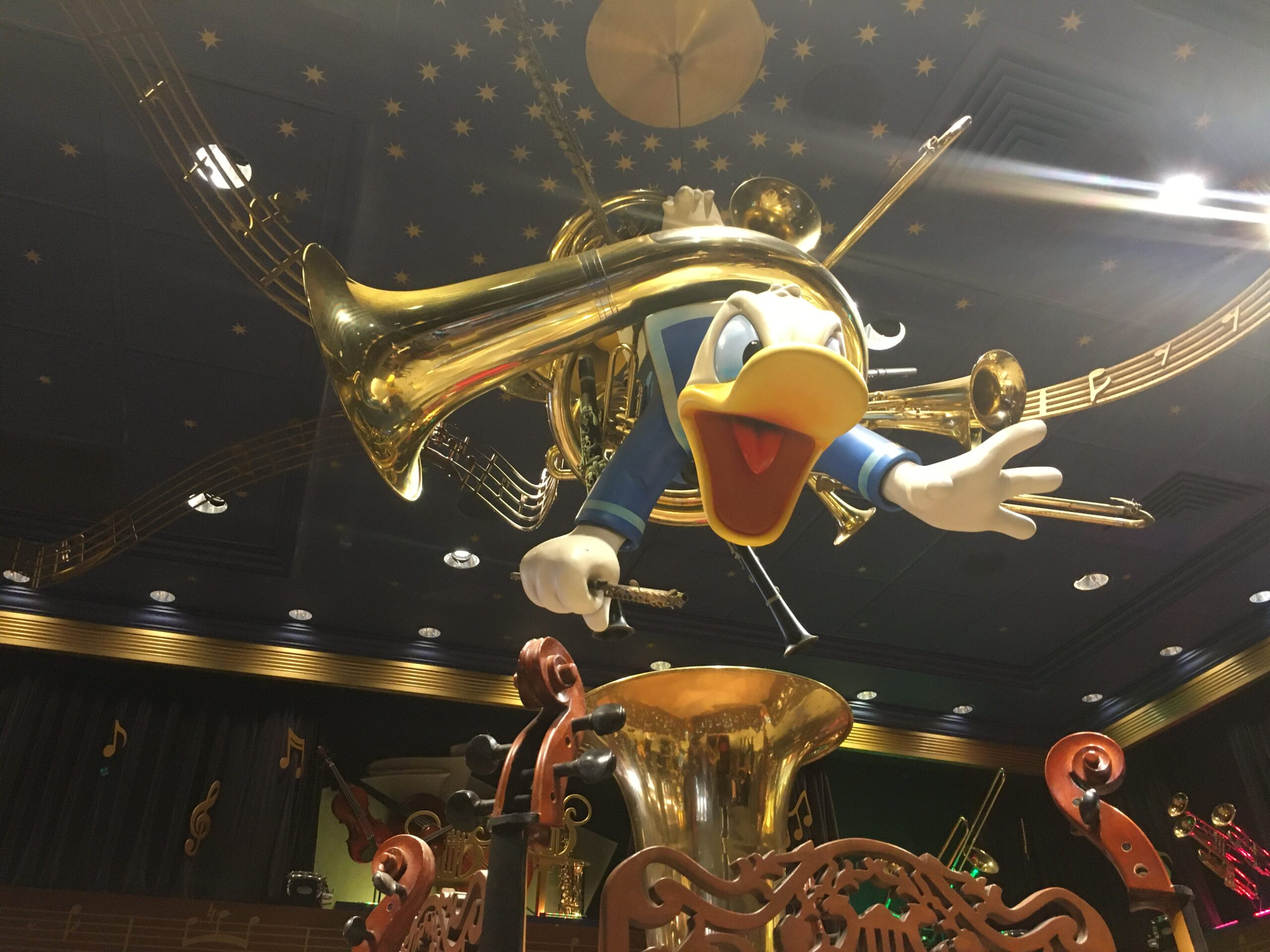 donald duck in a trombone at Magic Kingdom's PhilharMagic, a ride to include on a Magic Kingdom itinerary