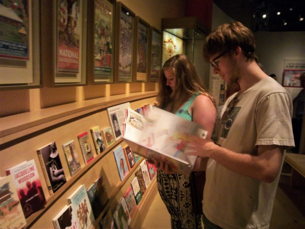 Two teens looking at the children's books at the George W. Bush Presidential Library in Dallas.