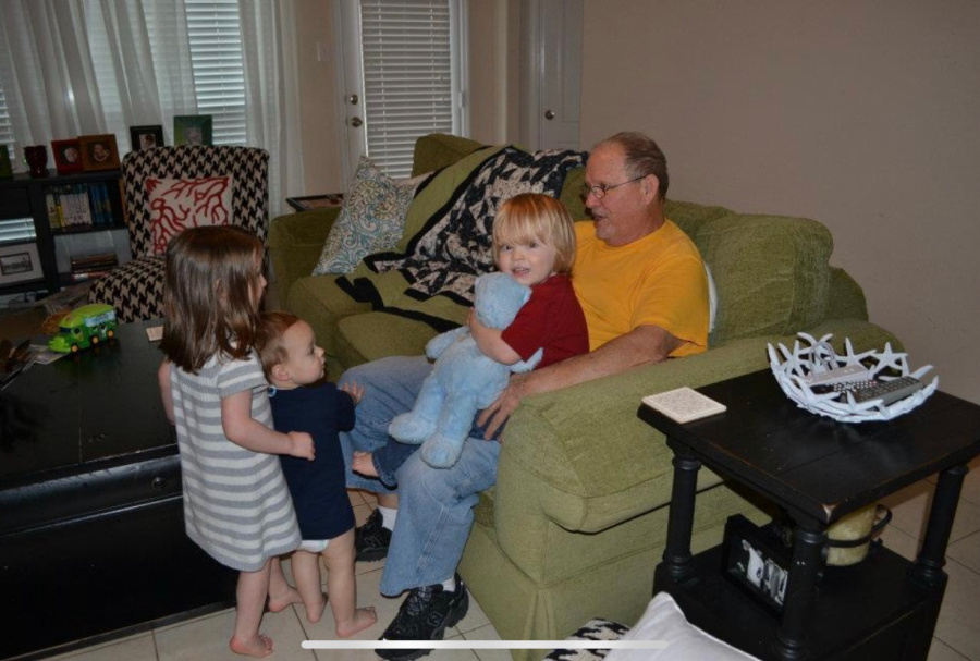 Grandpa and grandkids in a baby proof living room