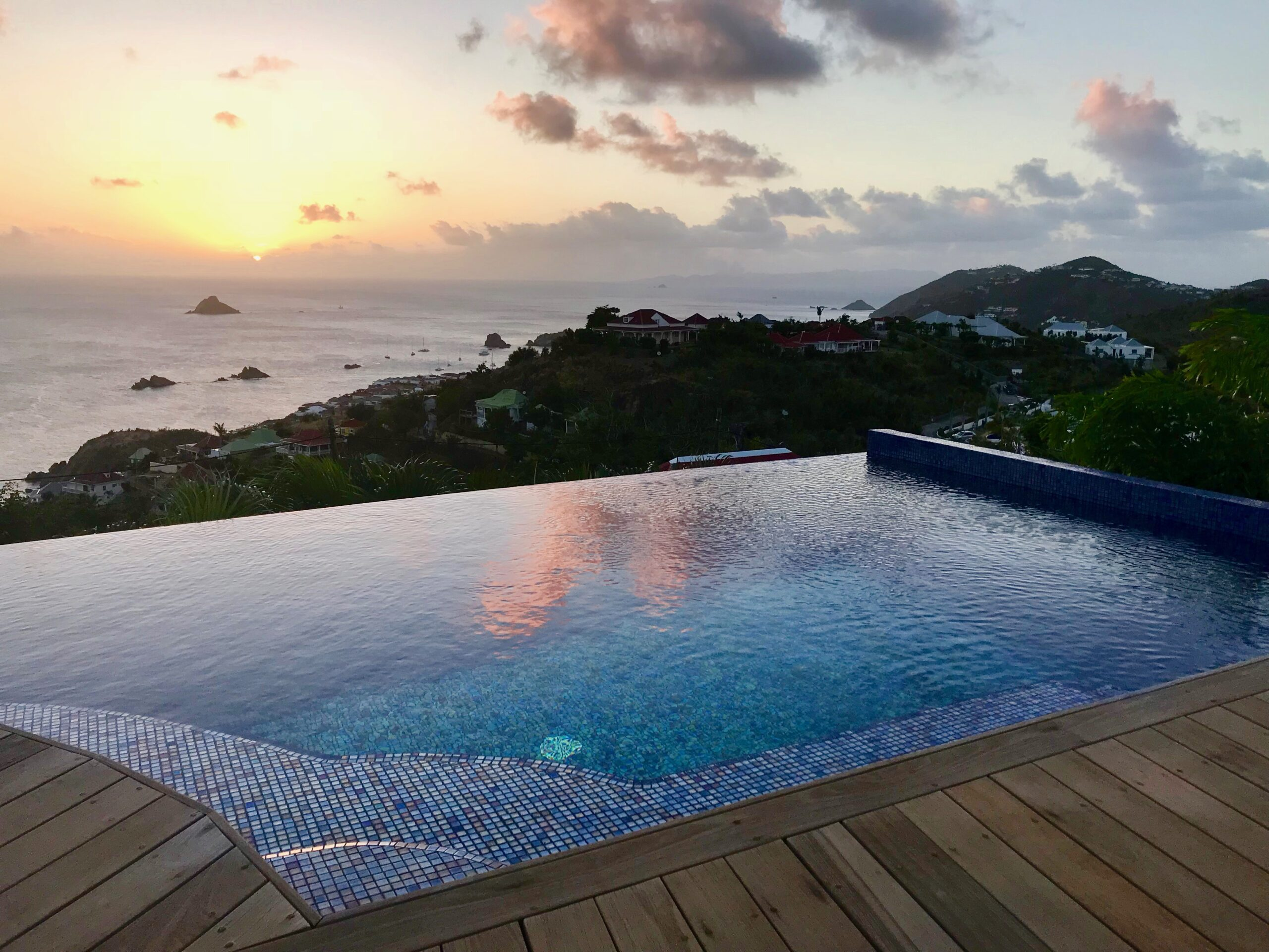 caribbean sunset with a private beach house pool