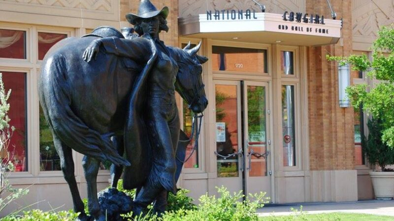 The statue of a cowgirl outside the National Cowgirl Museum and Hall of Fame in Fort Worth Texas