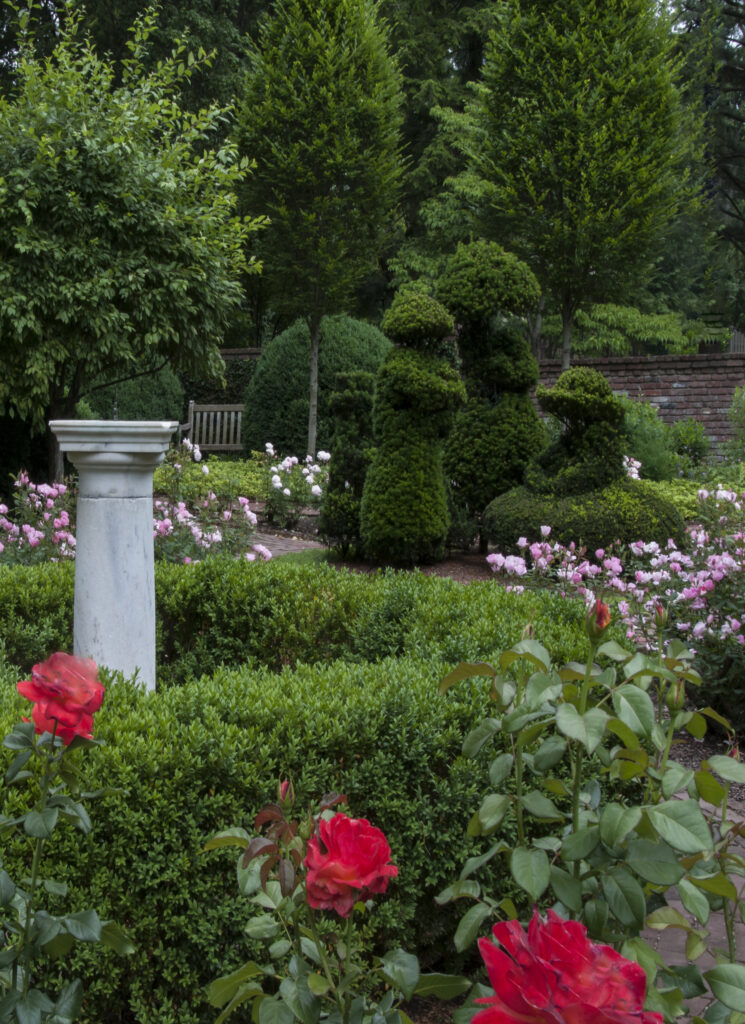 Garden with roses and a sundial at Ashland, the Henry Clay estate, a fun, free thing to do in Lexington KY