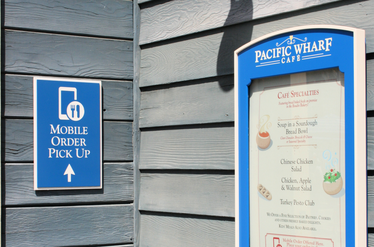 Mobile ordering sign next to Pacific Wharf menu