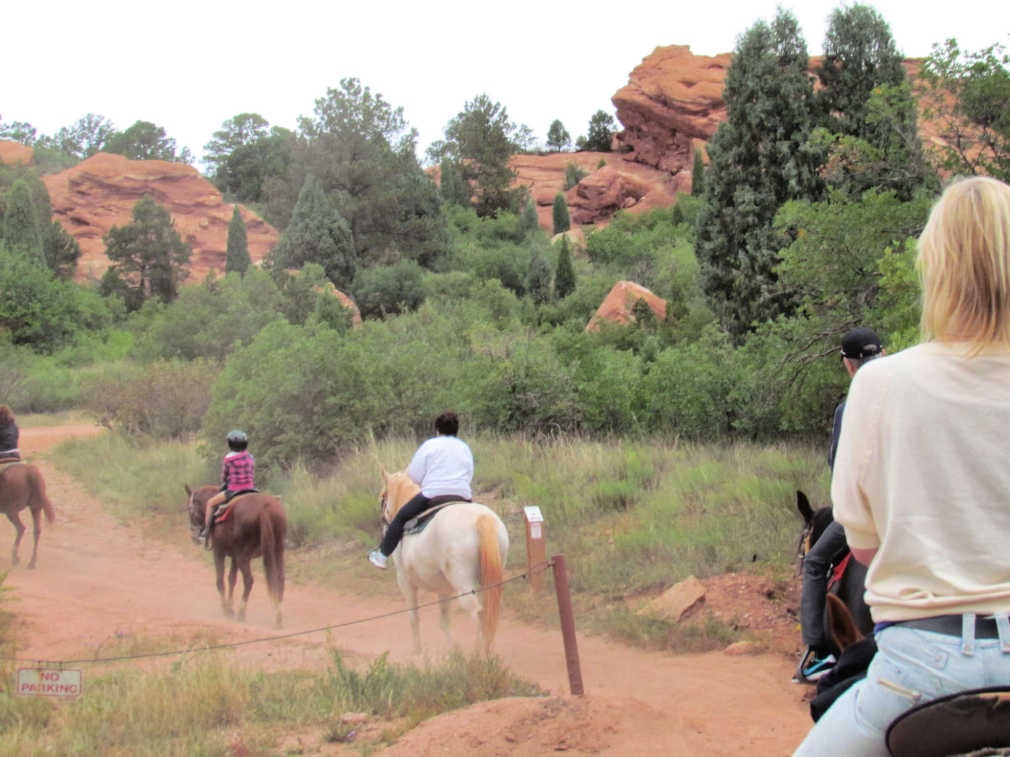 Rear view of several riders on a Garden of the Gods horseback ride