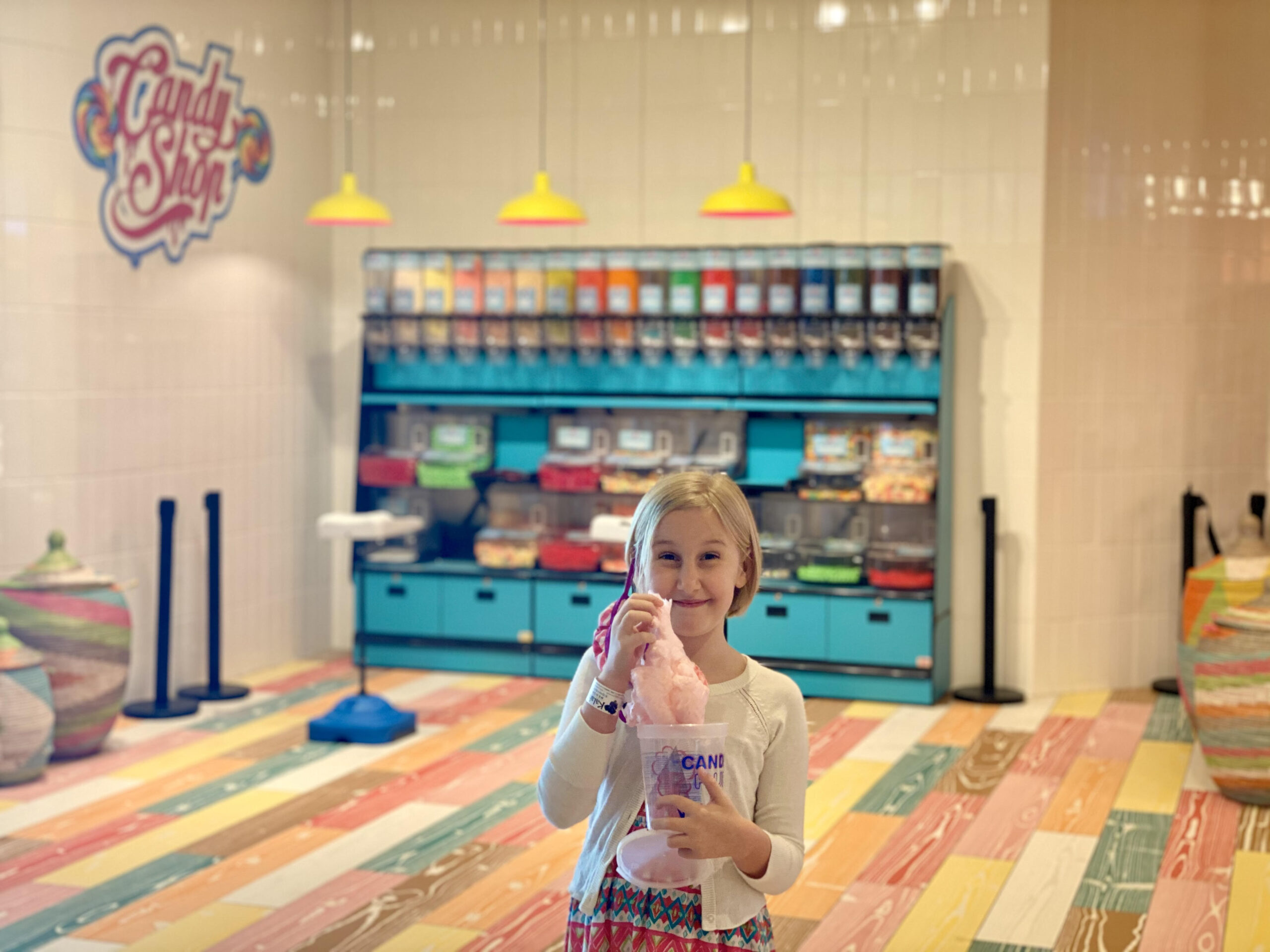 young girl with pink cotton candy in a candy shop at the Kalahari resort in Round Rock, Texas