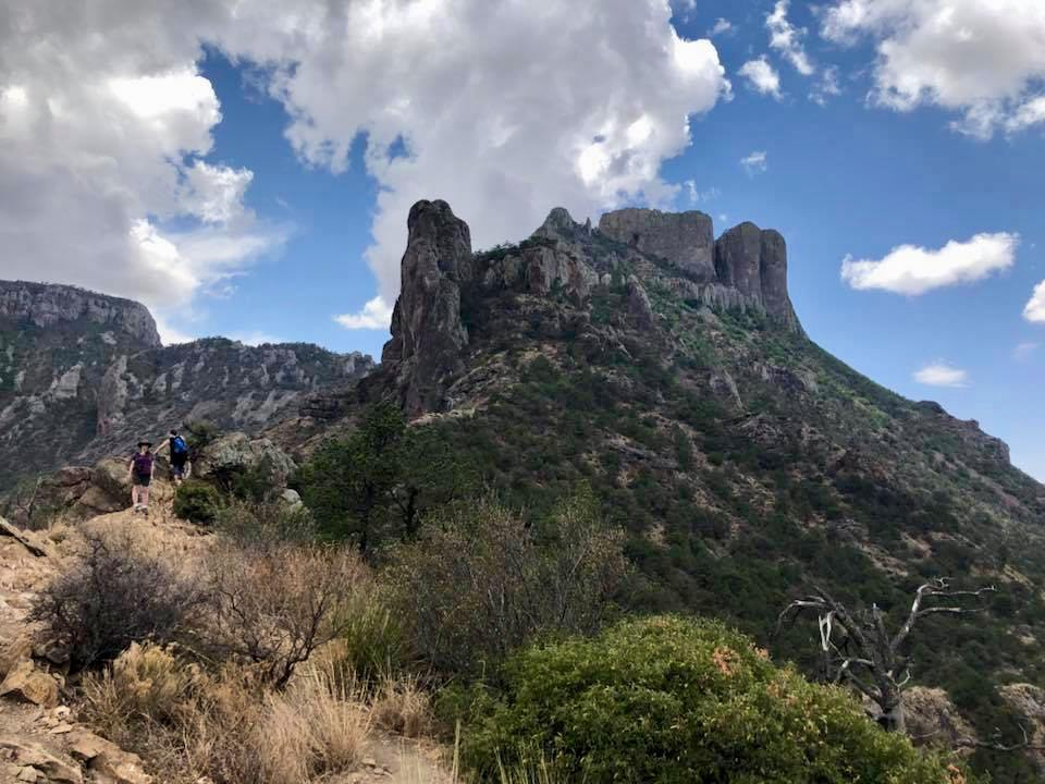 Flat topped mountain peak with scrub grass in foreground in Big Bend National Park