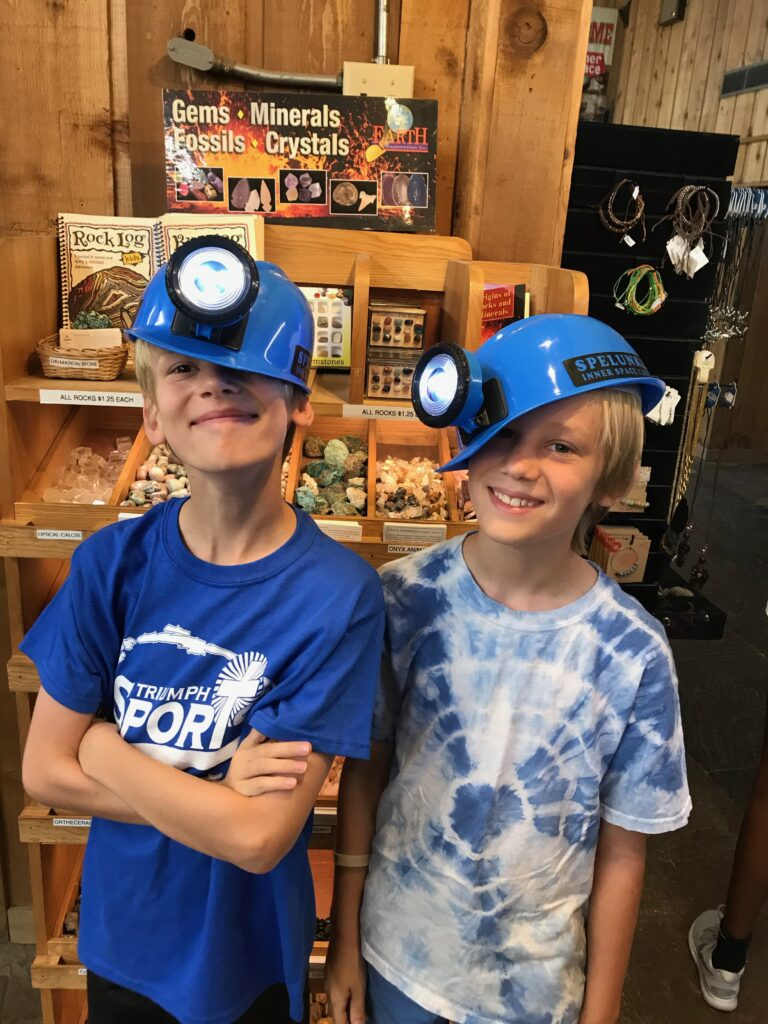 Boys clowning around at the Inner Space Caverns gift shop.
