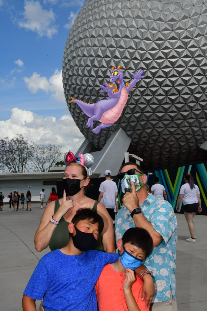 Family in front of EPCOT ball