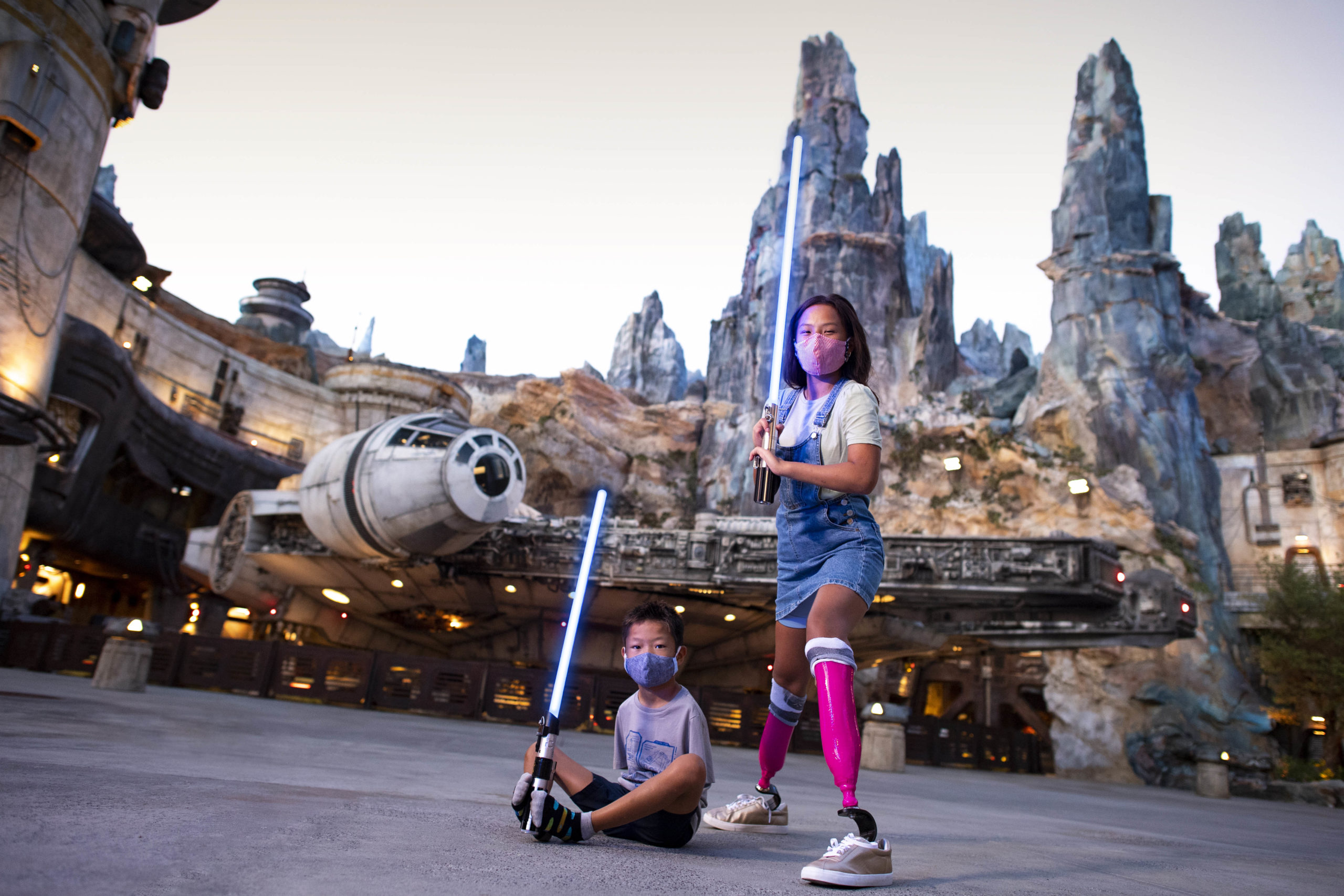 Kids with lightsabers at Disneyland