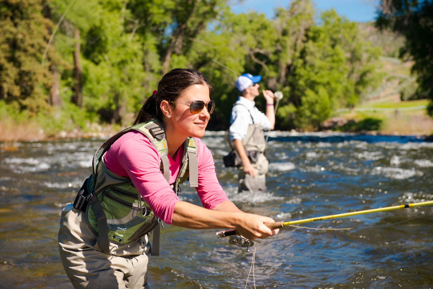 Woman flyfishing in Vail, CO, one of the fun things to do in summer