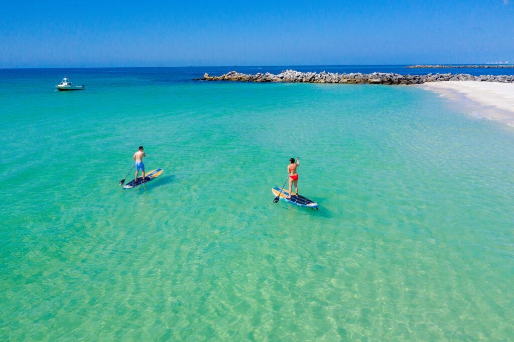paddleboarders off Shell Island in Panama City Beach FL