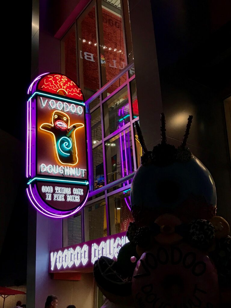 Neon sign for Voodoo Doughnuts at CityWalk