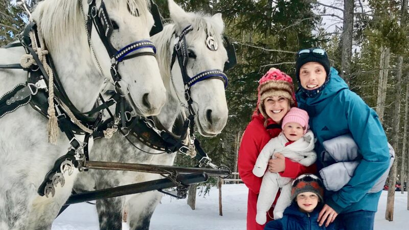 family with 2 sleigh ride horses in Frisco, CO