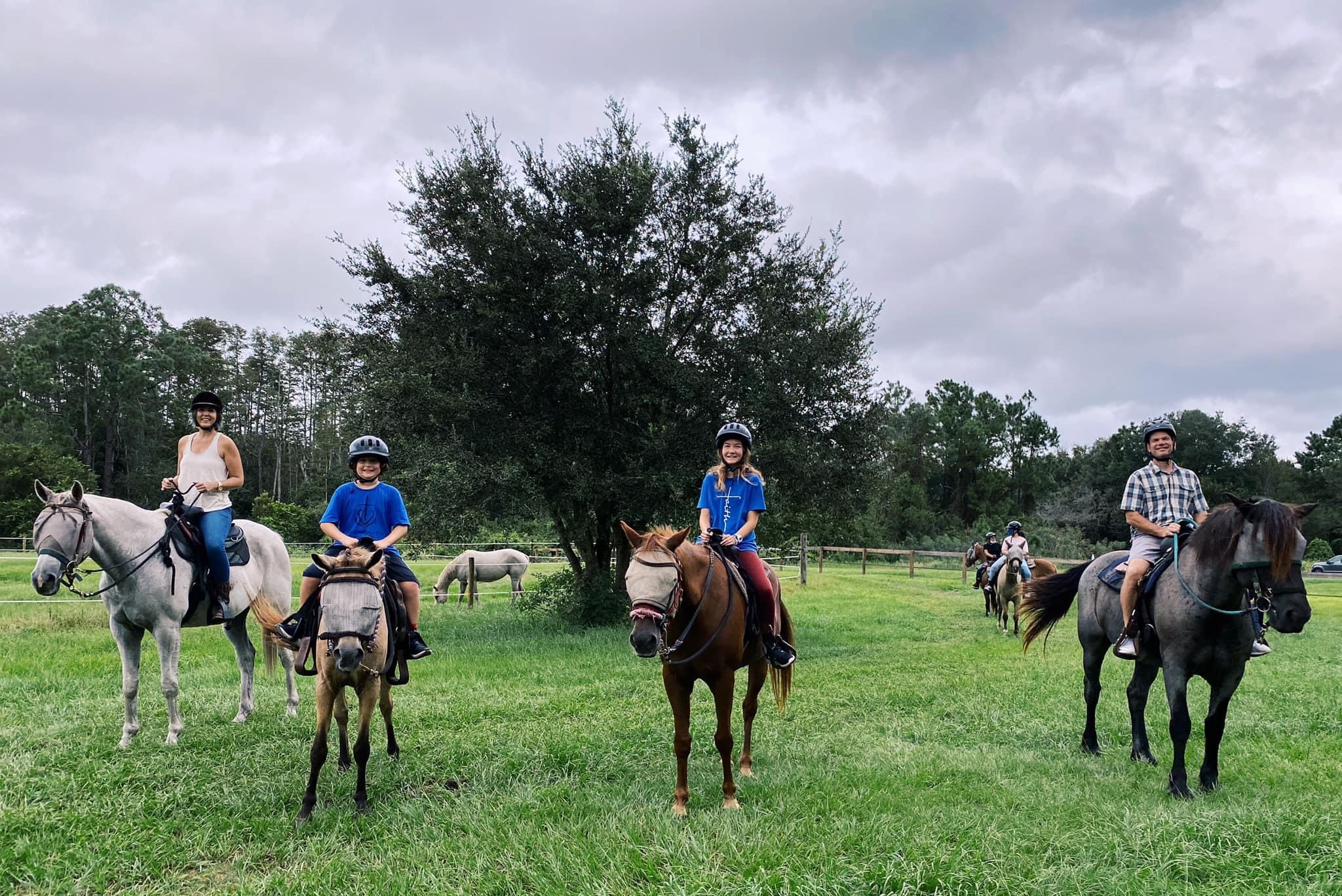 family on horseback at Lake Luisa State Park, a fun thing to do in Orlando