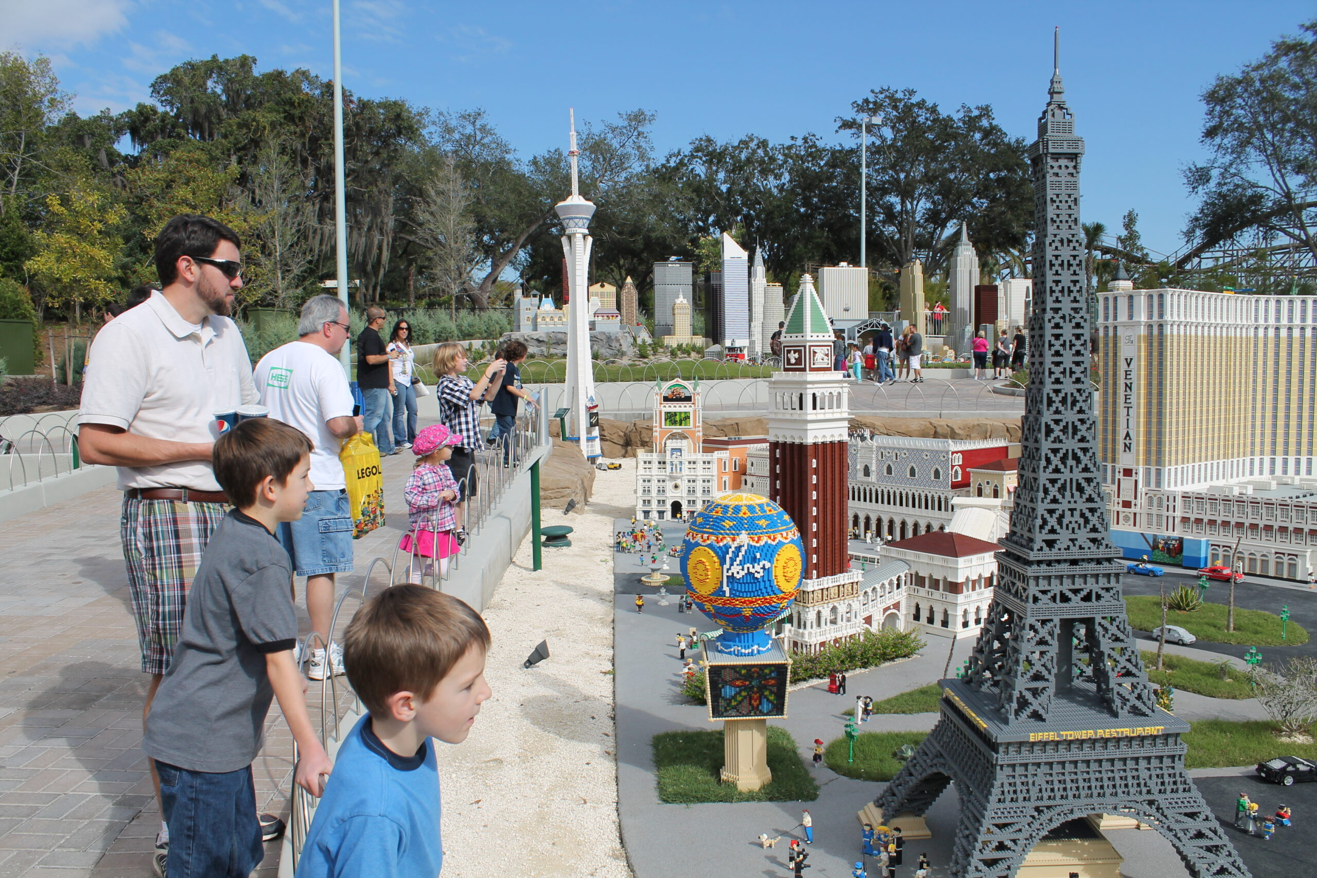 Adults and children admiring Miniland USA at LEGOLAND