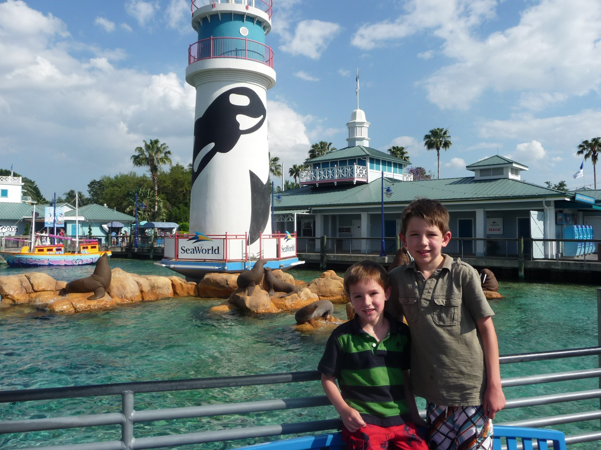 two smiling boys posing in front of a SeaWorld exhibit in Orlando FL