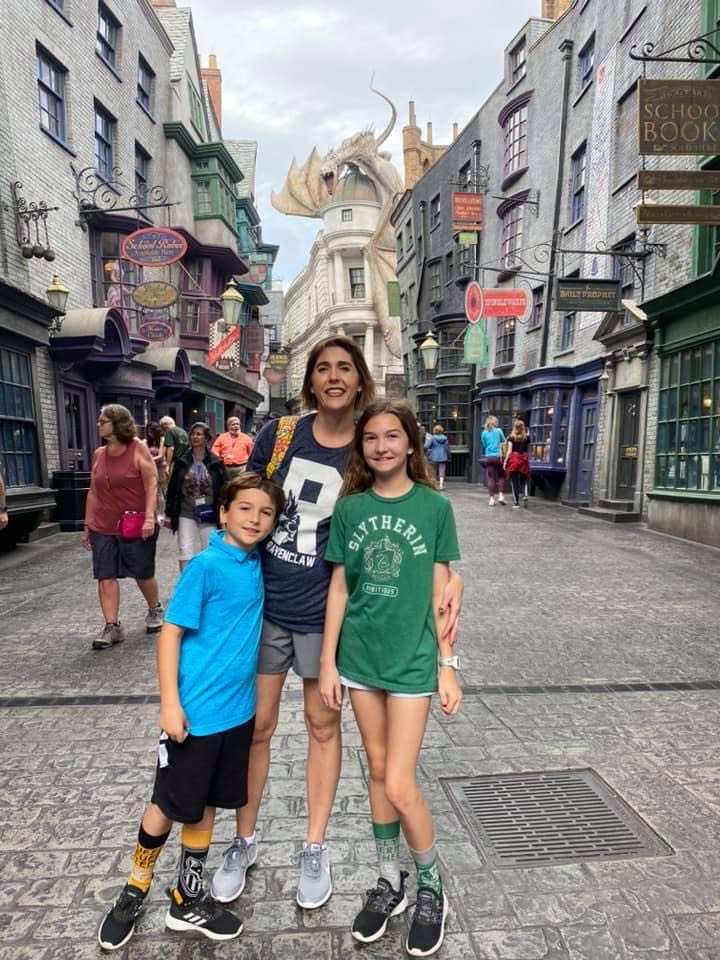 mom and children exploring Diagon Alley at Universal Studios, a fun thing to do with kids in Orlando