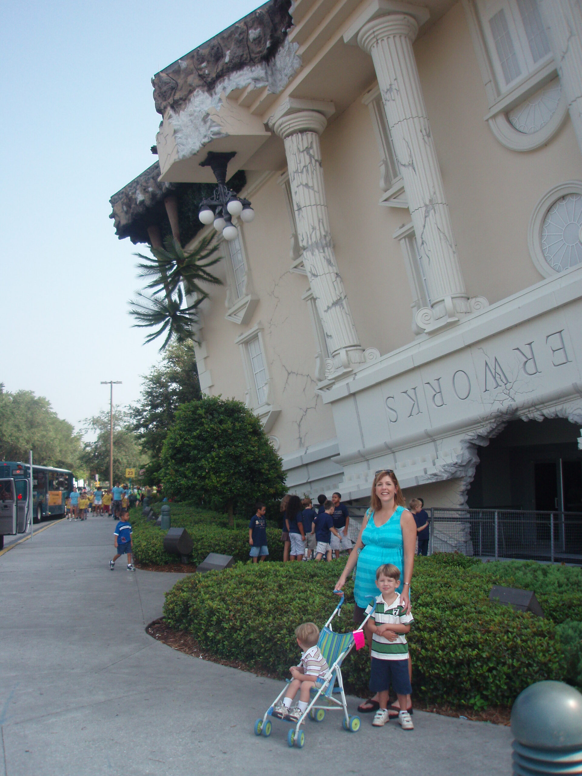 mom and children posing in front of Wonderworks in Orlando