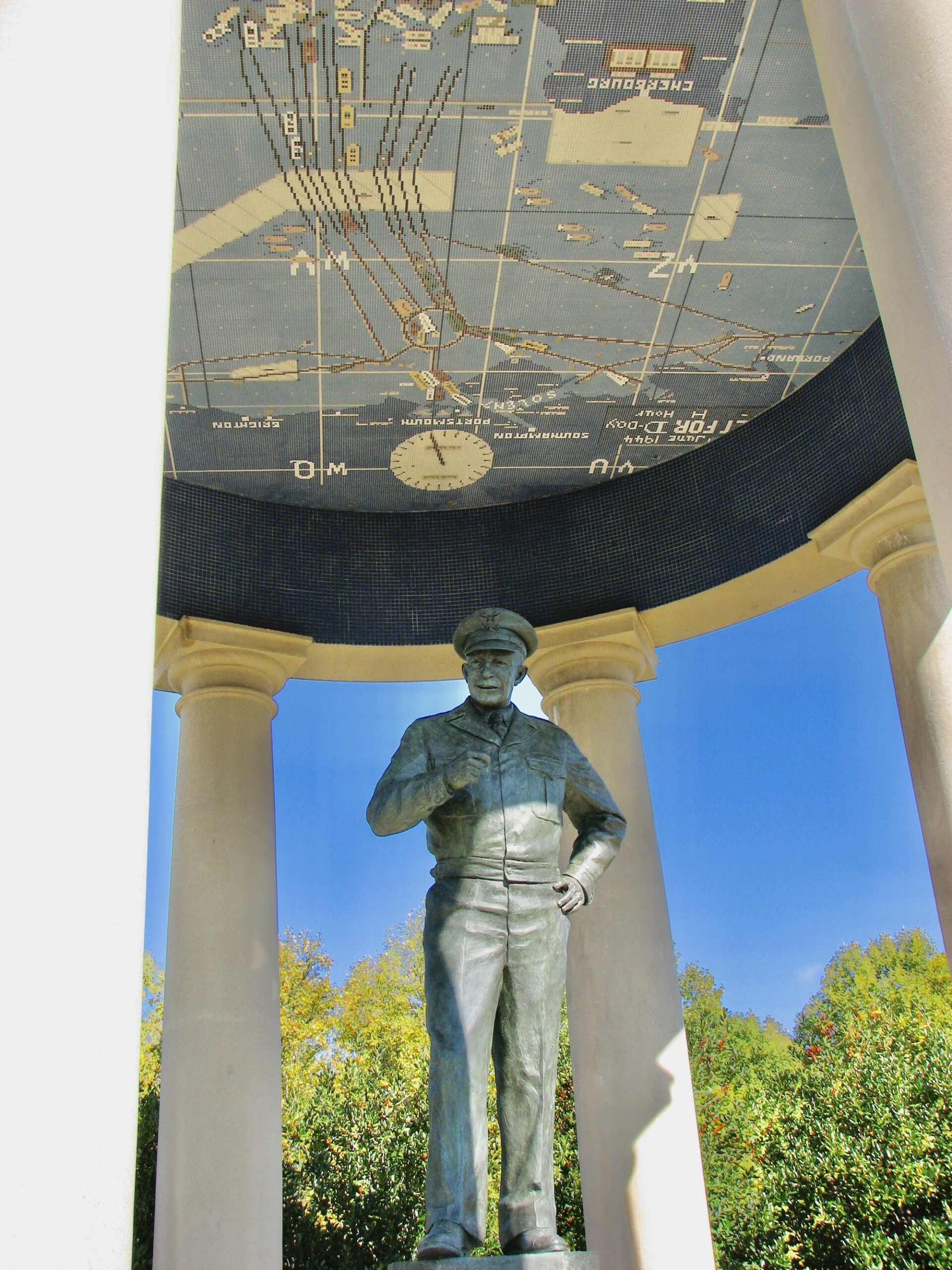 D-Day Memorial in Bedford covers Gen. Eisenhower with a map.