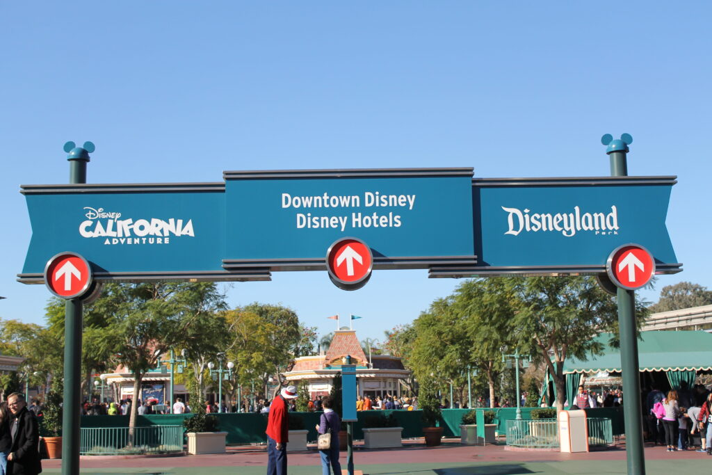 Signs for the theme parks in Disneyland Resort