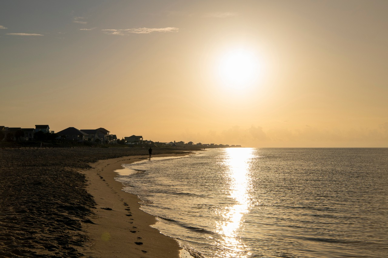 Sunrise over St. George Island, one of the best Florida panhandle beaches.