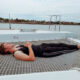 Teen lying on netted deck of sailboat one of the best things to do in St. Augustine with kids