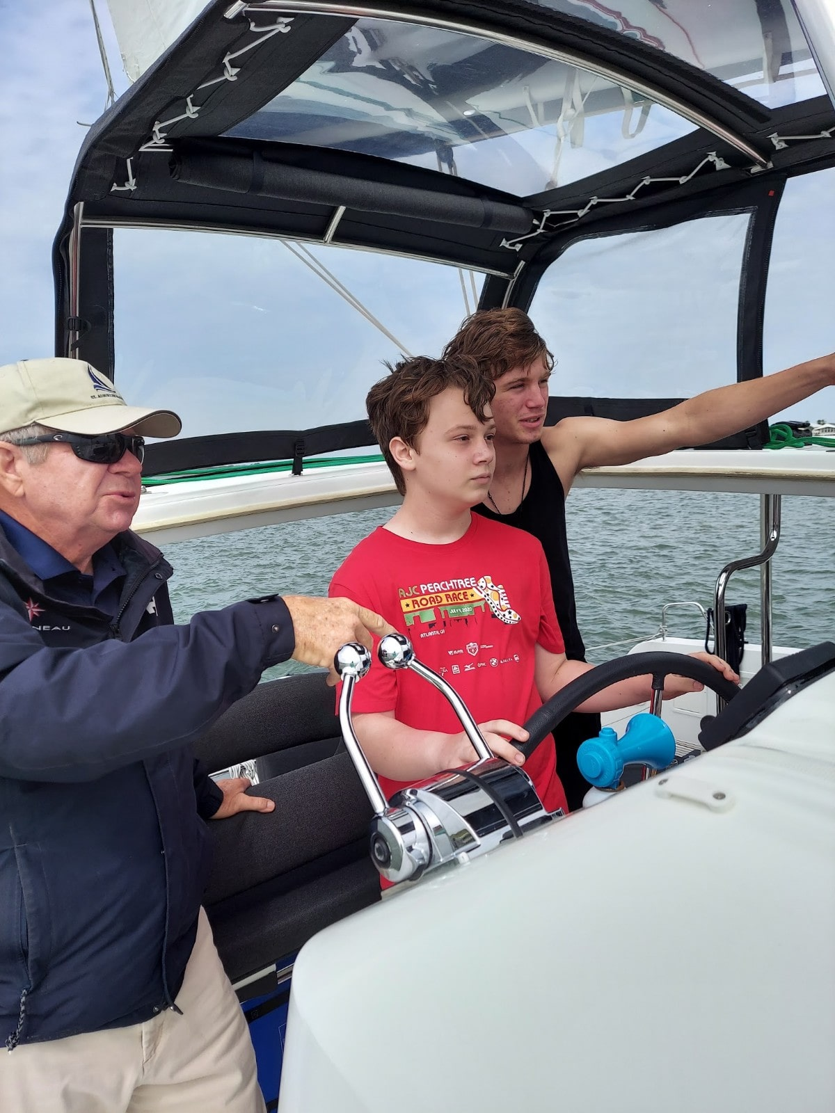 Kids can have a turn steering the boat during a St. Augustine Sailing charter.