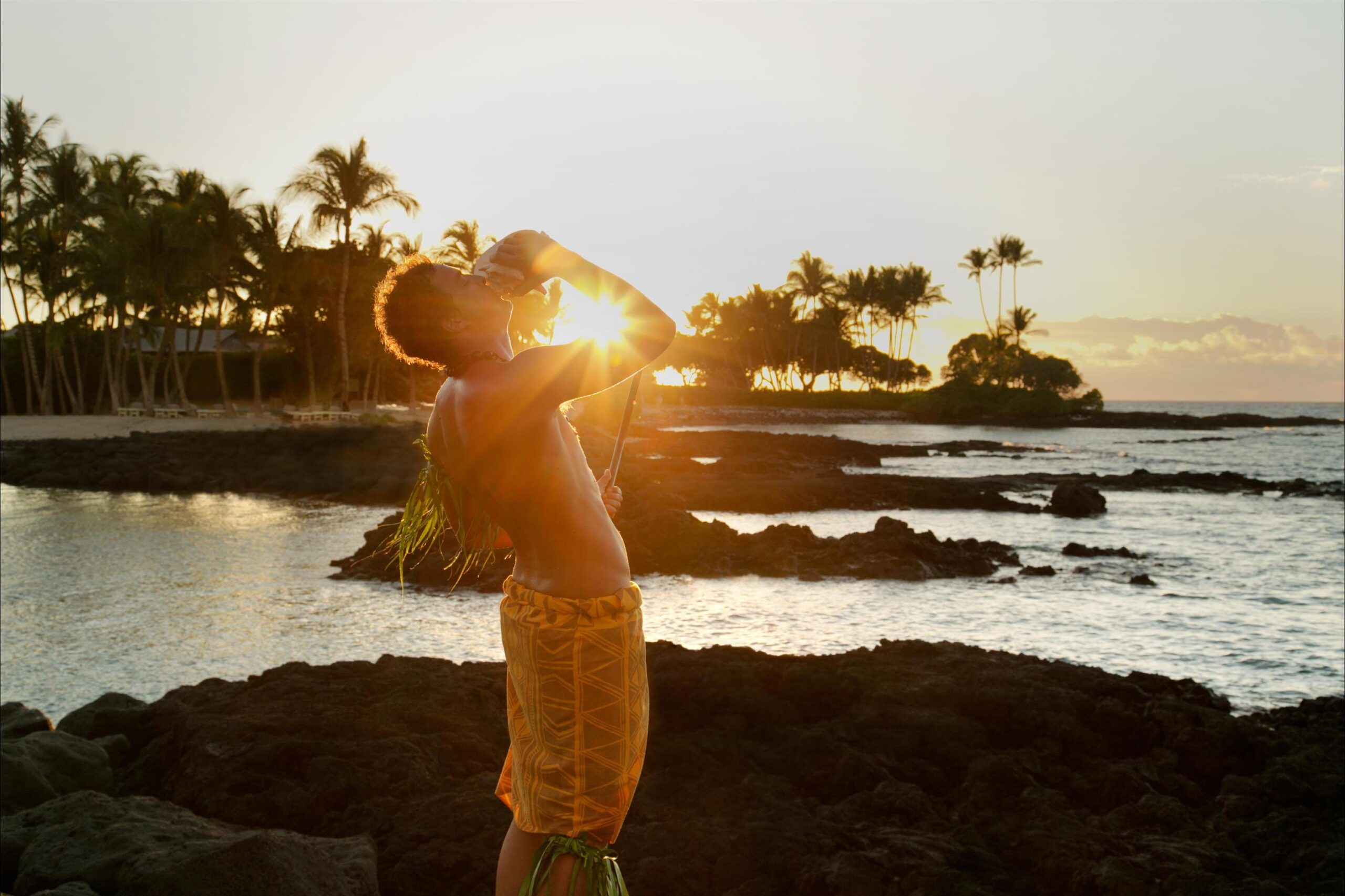 Fairmont Orchid review: conch blowing ceremony at sunset at fairmont orchid