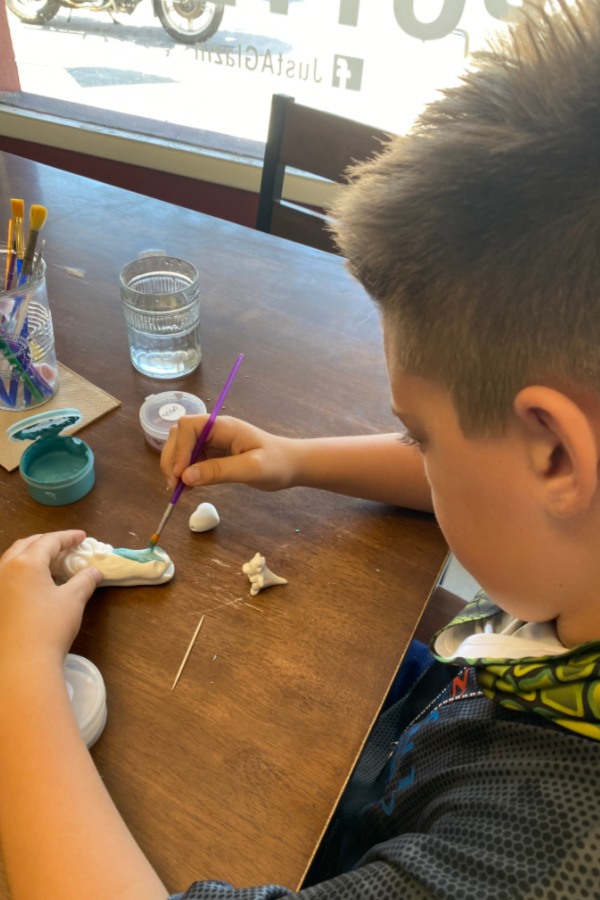 Pottery painting with grandkids on TravelingGrandparents