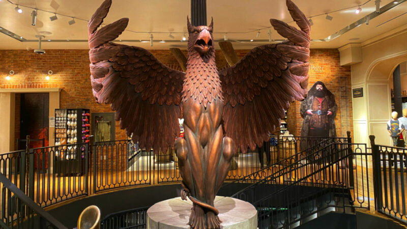 Griffin Stands Guard in Harry Potter Store NYC