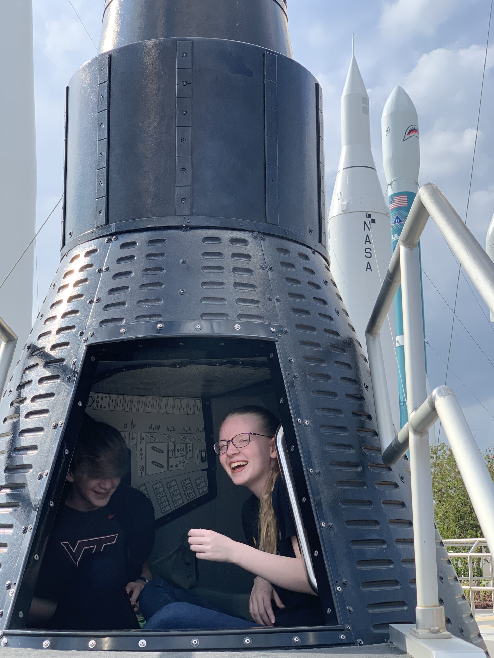 teenage brother and sister in lunar lander at kennedy space center rocket garden