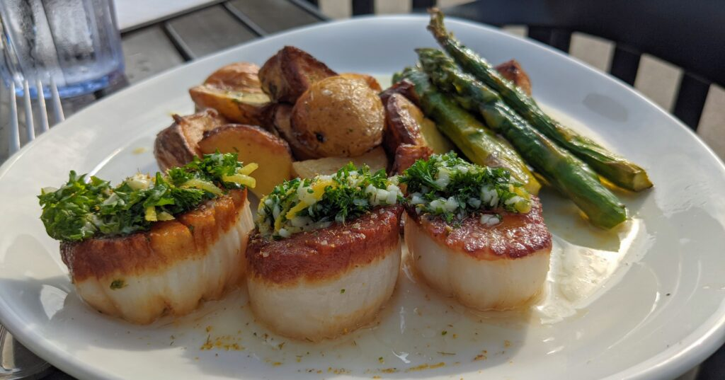 The scallop dinner from Mermaid, one of the best Saugatuck restaurants.