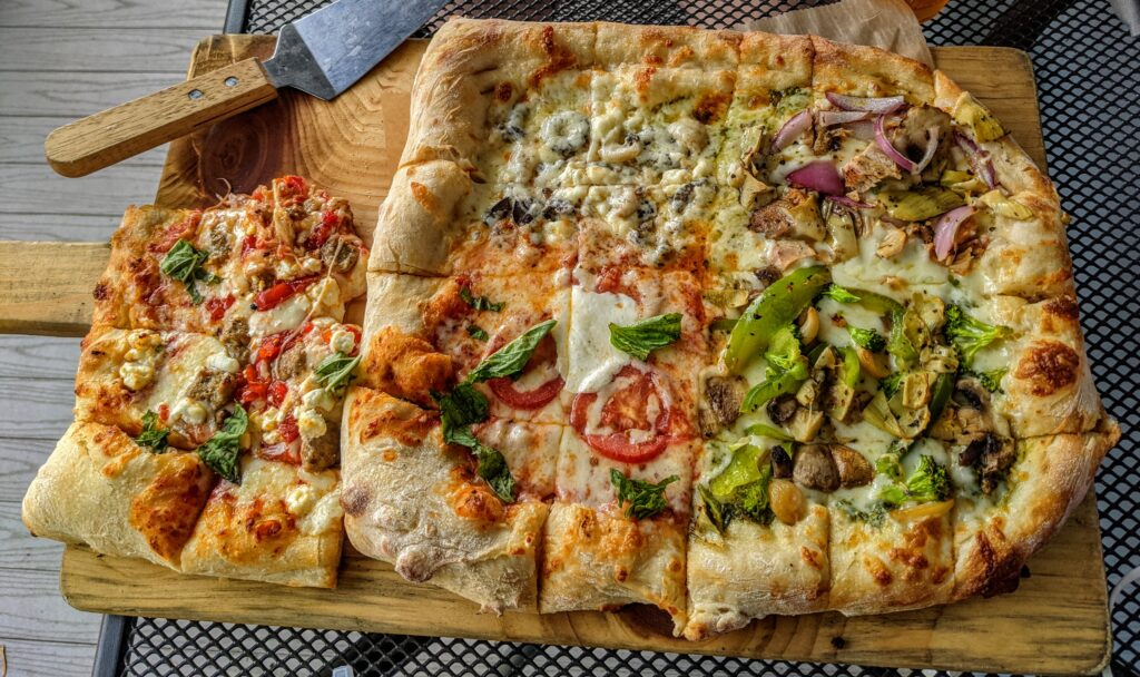 large pizza cut into tasting strips
